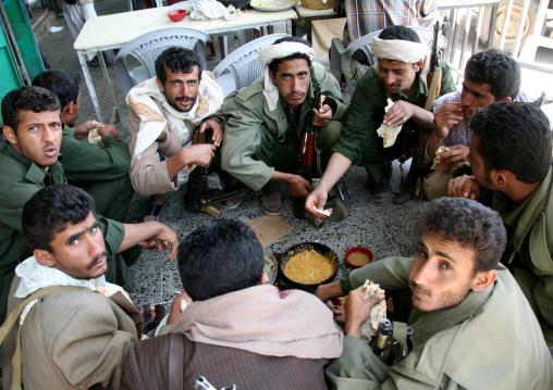 Police Men Squatting In Circle And Sharing Dinner, Shahara, Yemen