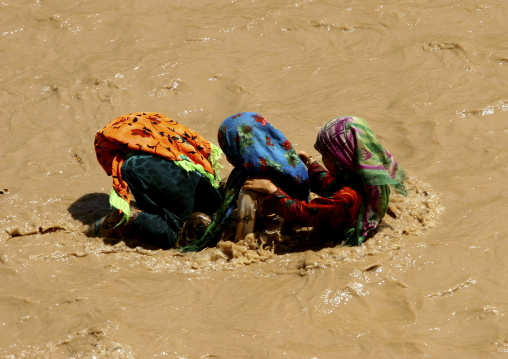 Three Girls Playing In A River Using A Palm Tree As A Flotation Boat, Tihama, Yemen