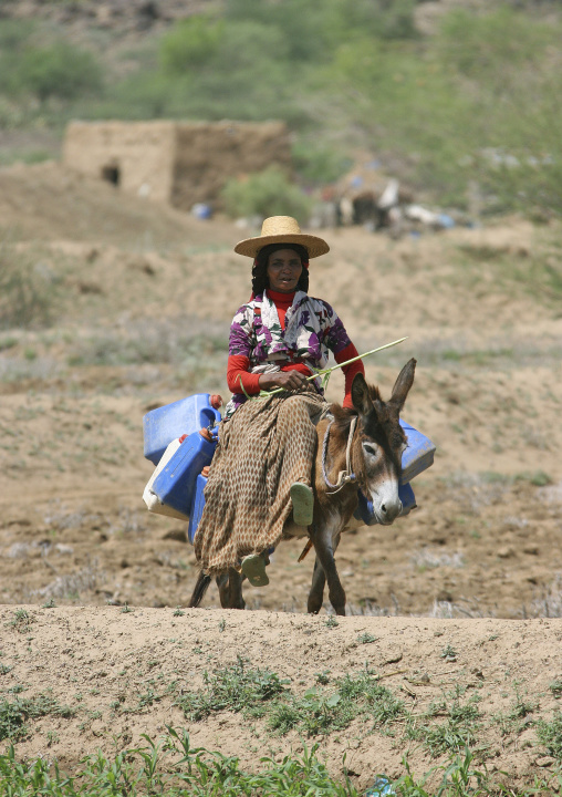 Woman With A Hat Riding A Donkey And Looking For Water, Hodeidah, Yemen