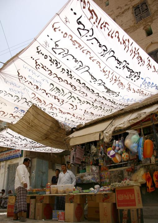 Small Shop Under A White Awning With Arabic Writing, Tarim Market, Yemen