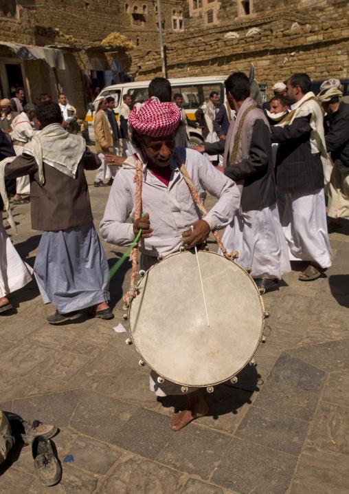 Man Playing Drum At A Wedding In Thula, Yemen