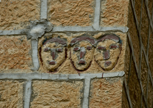 Three Faces Carved On A Wall, Ibb, Yemen