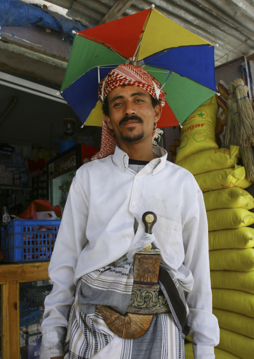 Man Wearing A Umbrella Over His Turban And Carrying A Dagger, Rada, Yemen