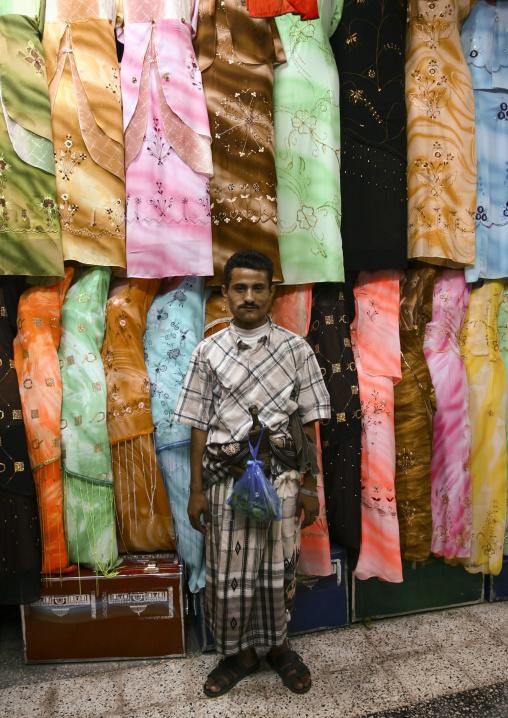 Man Standing In Front Of A Clothes Shop In Al Hodeidah Souq, Yemen